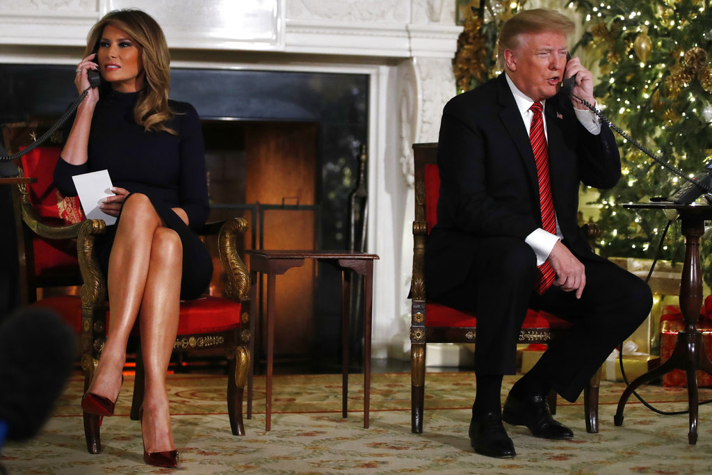 Donald Trump and Melania Trump speak on the phone while sharing updates to track Santa's movements from the North American Aerospace Defense Command Santa Tracker on Christmas Eve.
