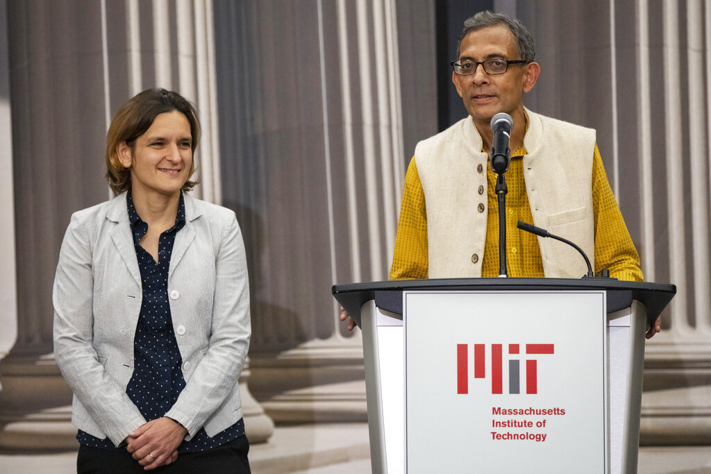 Abhijit Banerjee (right) at a news conference with Esther Duflo at MIT on Monday, October 14, 2019.