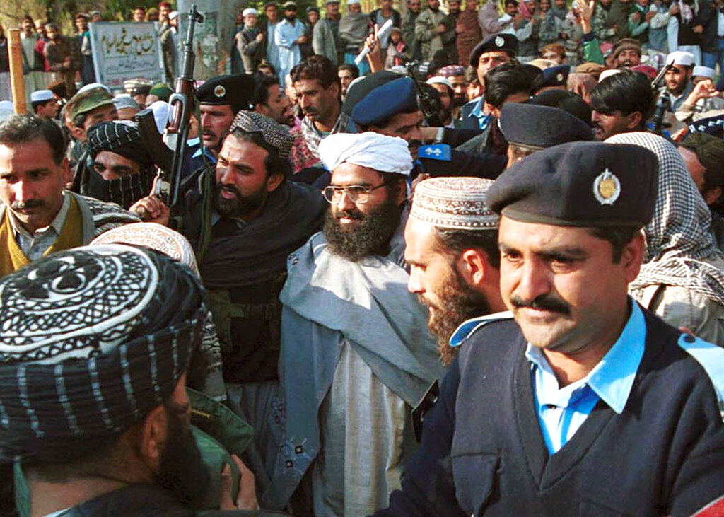 In this January 27, 2000 file photo, Jaish-e-Mohammad leader Masood Azhar (centre, in glasses and white turban), arrives in Islamabad. JeM was quick to take responsibility for the Pulwama terror attack on February 14, 2019.