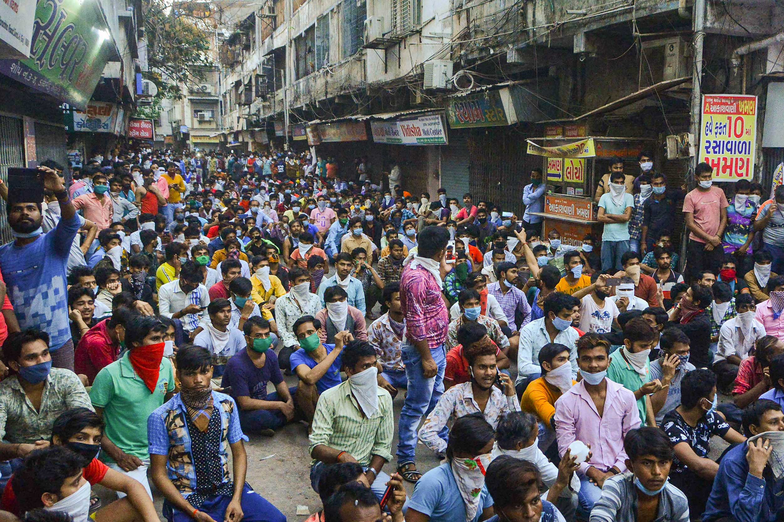 Migrant workers in Surat on Tuesday. The Stranded Workers Action Network (Swan), a group of researchers working on the implementation of the rural job scheme, tracked the migrant workers stranded across India between March 27 and April 13.
