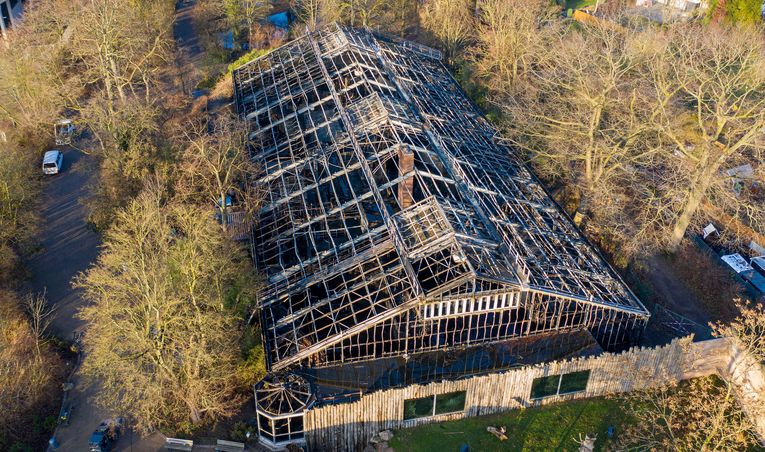 This January 1, 2020, picture, shows a burned down animal house at the Zoo in Krefeld, Germany.