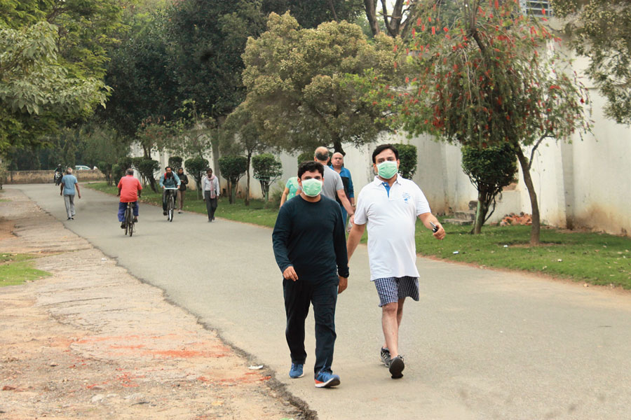 Morning walkers with masks in Beldih, Jamshedpur, on Tuesday.