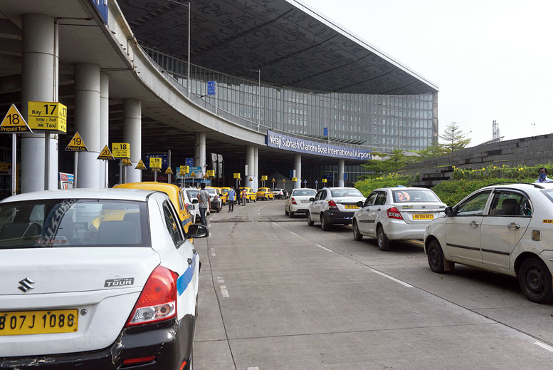 Taxis at the airport, where touts are on the prowl