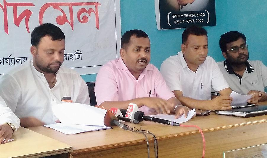 Azizur Rahman (centre) addresses the media in Guwahati on Saturday