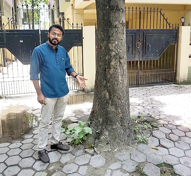 Biswajit Roy Chowdhury shows how the base of a tree has not been given space to grow.