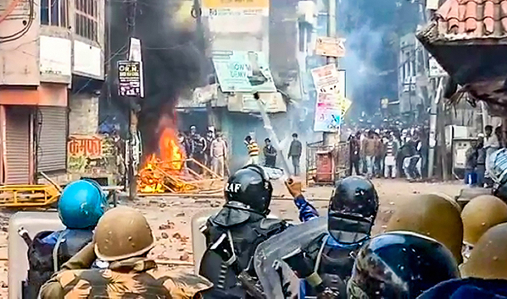 Police personnel clash with protestors demonstrating against the Citizenship Amendment Act in Rampur, Saturday, December 21, 2019.