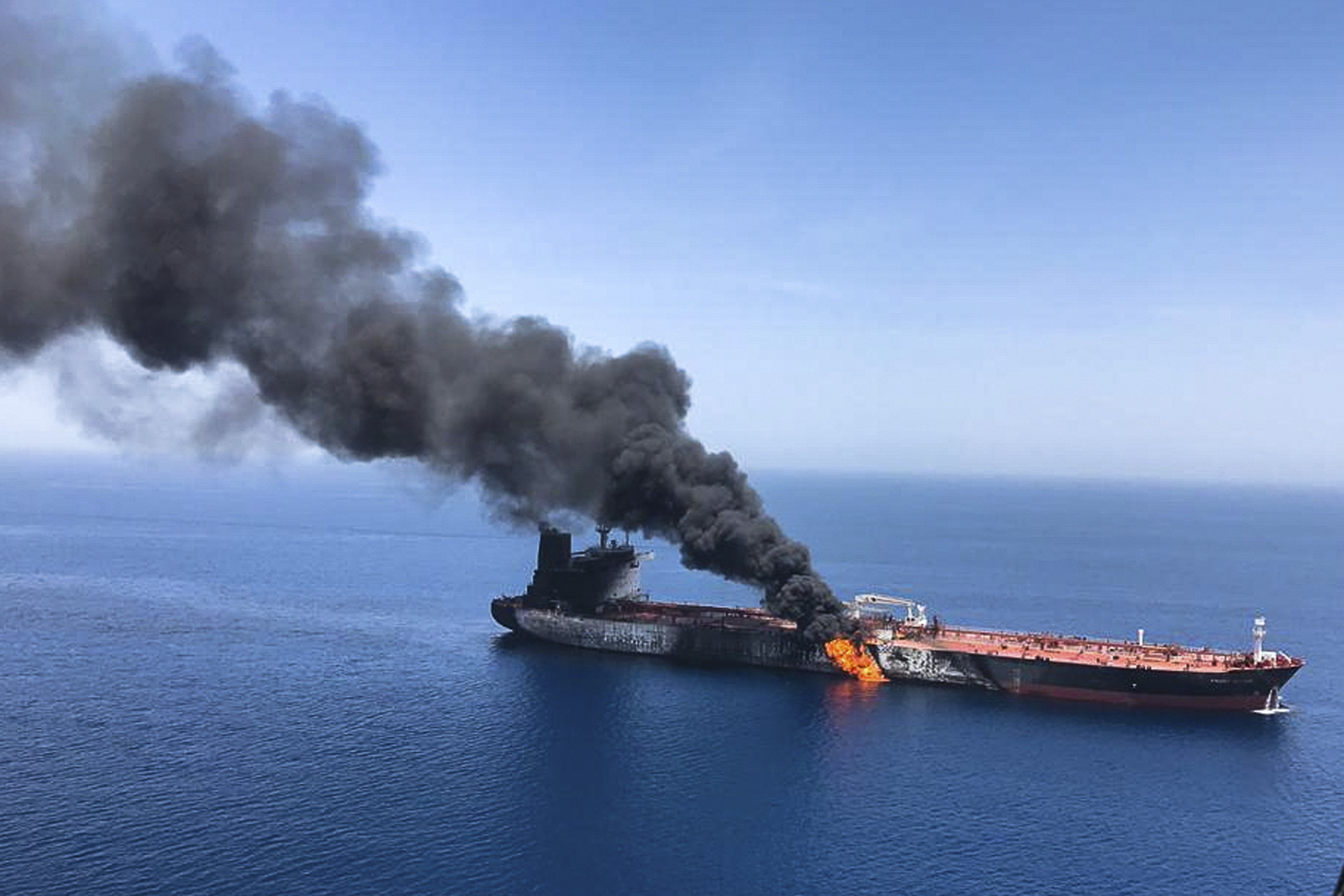 An oil tanker on fire in the sea off Oman on Thursday, June 13, 2019.