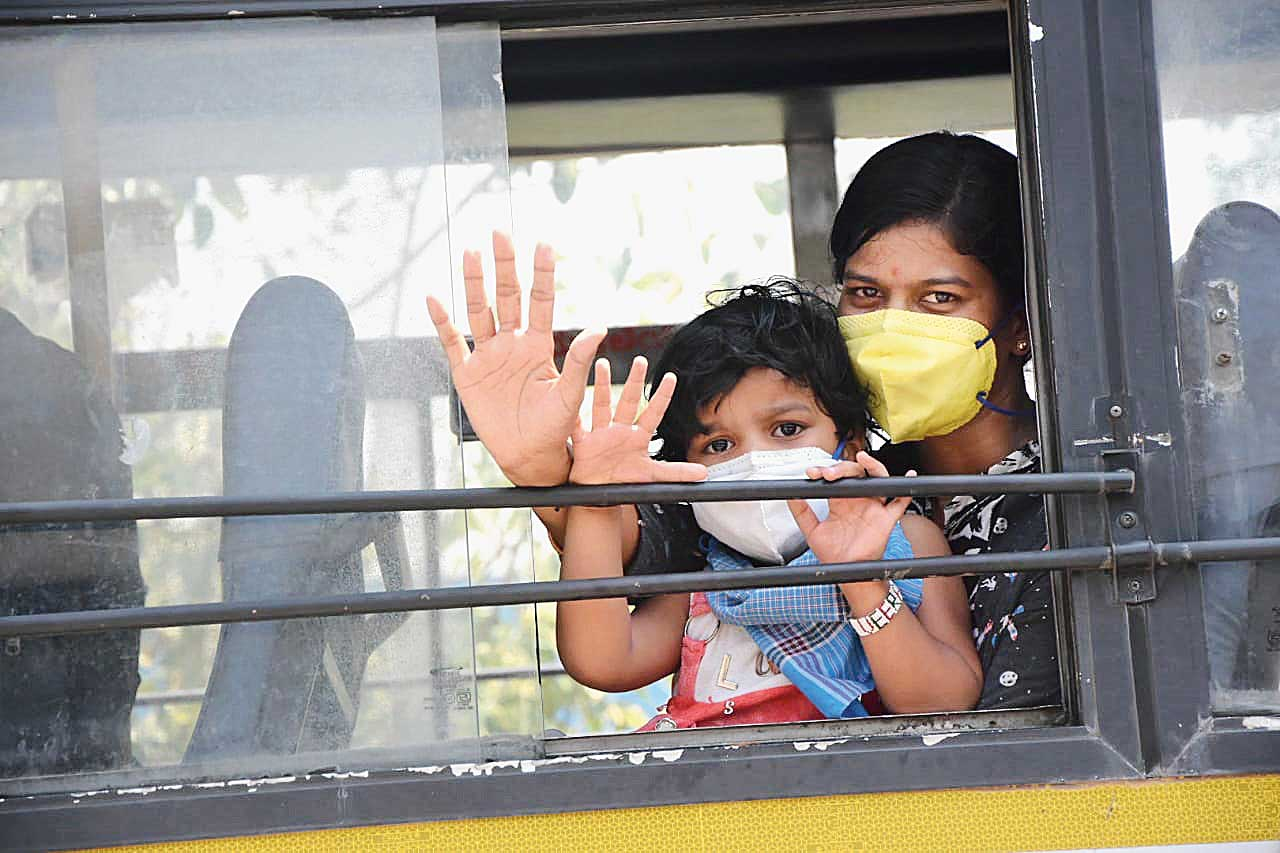 A woman and a child at the Bangalore bus station to catch buses operating to other districts in Karnataka on Saturday.