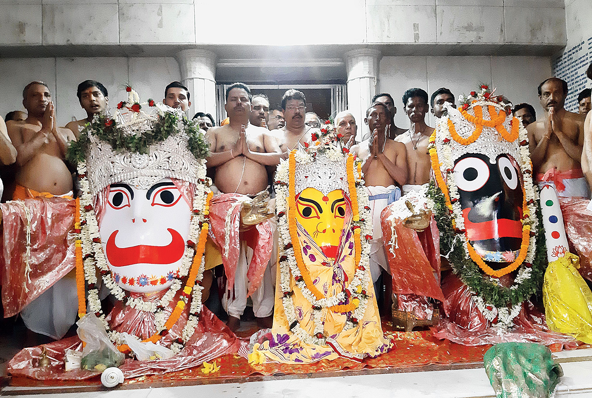Ready for chariot ride: Priests perform the netra daan ritual at Jagannathpur temple in Ranchi on Wednesday  ahead of the Rath Yatra festival that begins on Thursday.