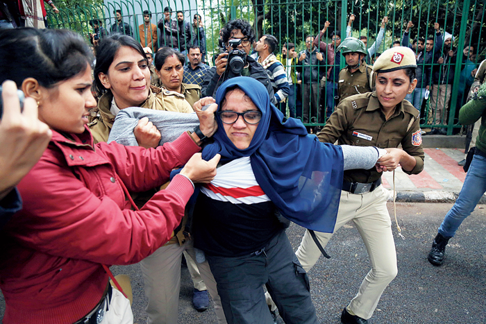 A student being dragged by police during the protest