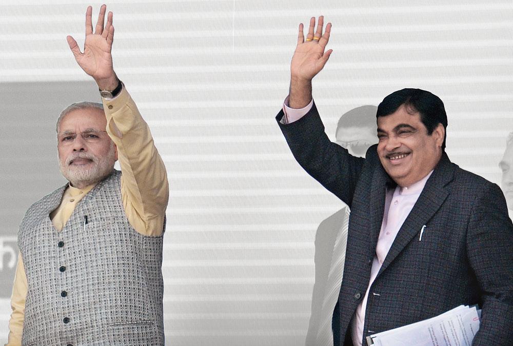 PM Narendra Modi with senior BJP minister Nitin Gadkari.