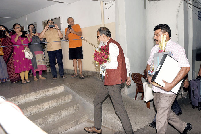 Residents of Saptaparni on Ballygunge Circular Road go click-click as Nobel laureate Abhijit Vinayak Banerjee reaches home on Tuesday evening
