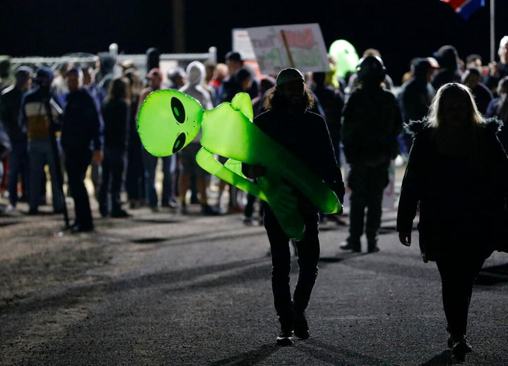 A mans with an inflatable alien near Rachel, Nevada, on Friday