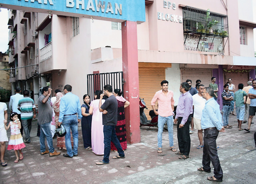 Residents gather near Madhusudhan Rajeswar Apartment in Mango, Jamshedpur, on Tuesday