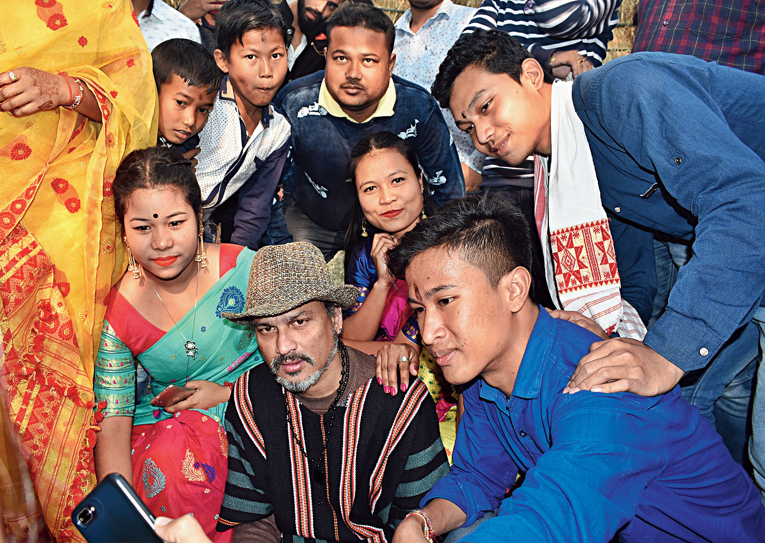 Youths take a selfie with Zubeen Garg at the venue in Tangla on Thursday.