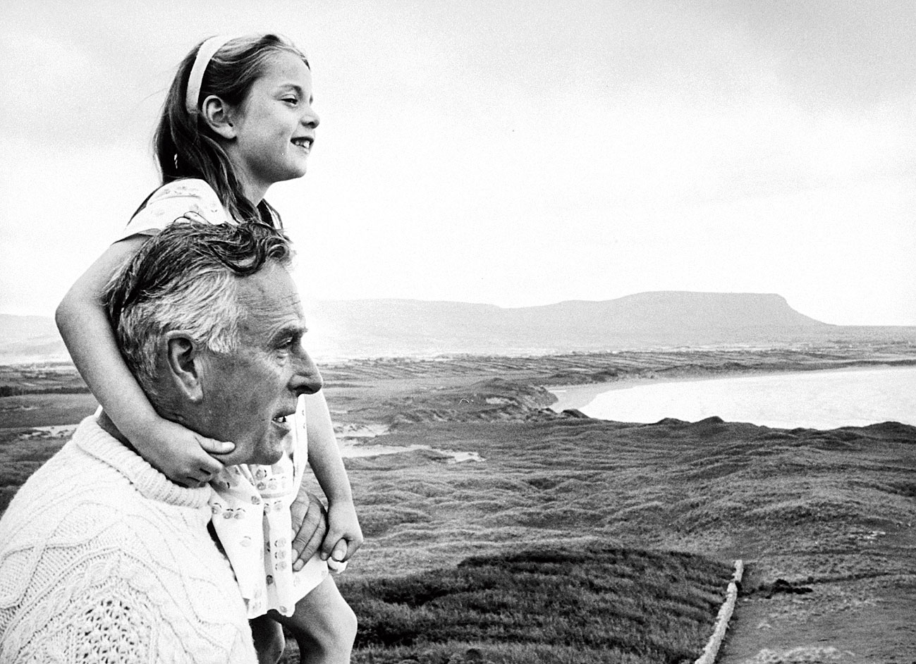 Lord Louis Mountbatten plays with his granddaughter in the grounds of the Classiebawn Castle in Mullaghmore, Ireland.