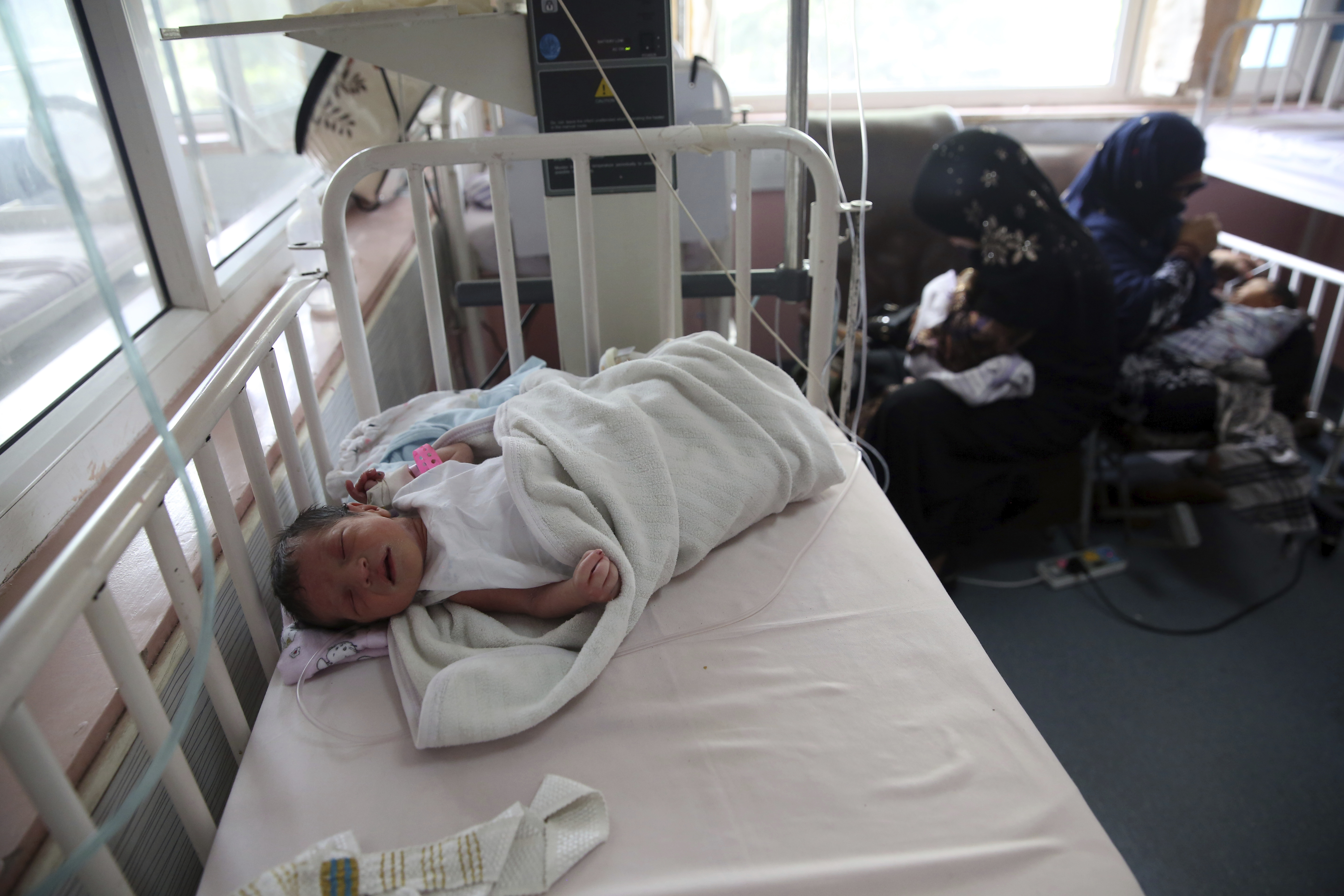Newborn babies are cred for at the Ataturk Children's Hospital a day after they were rescued following a deadly attack on another maternity hospital, in Kabul