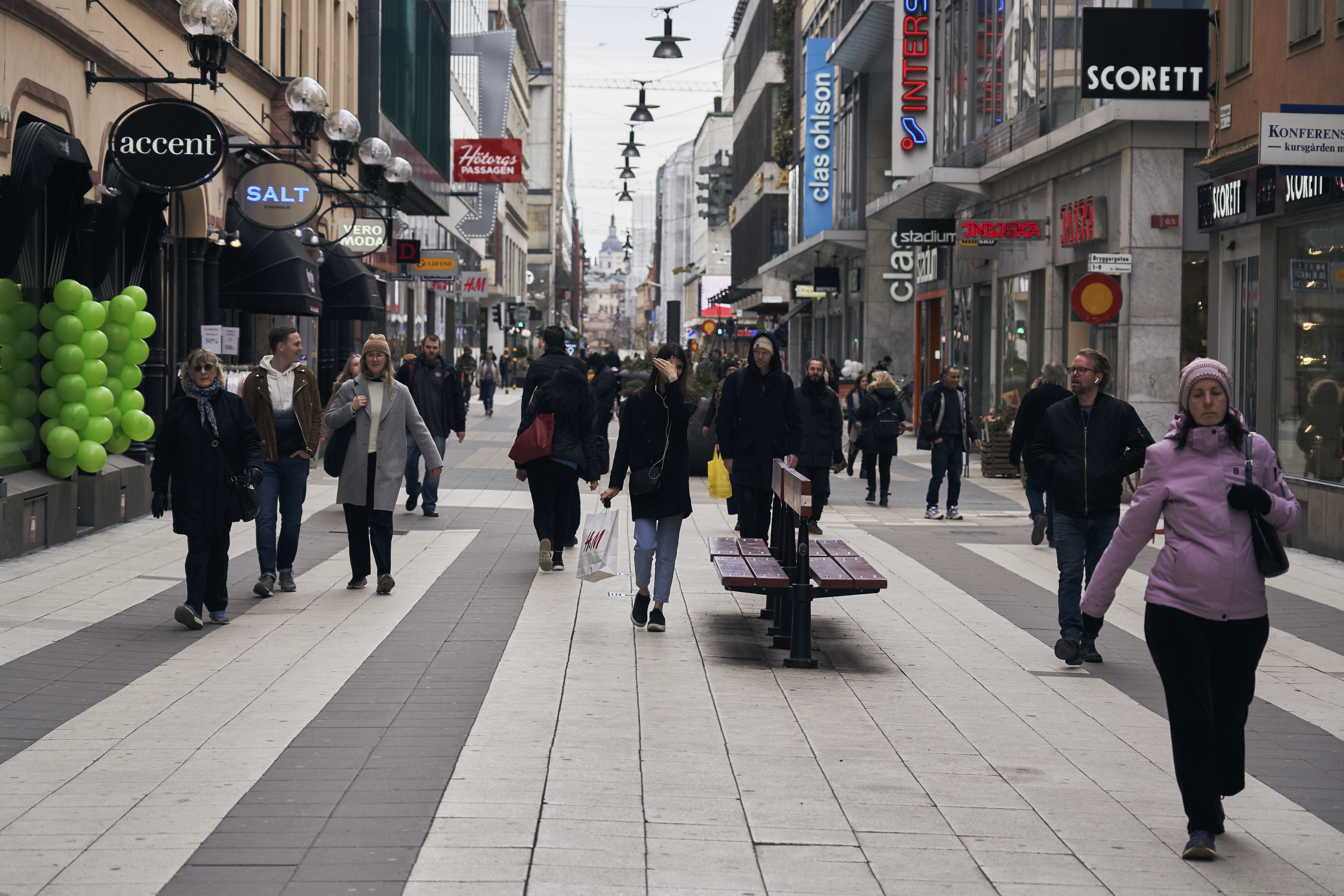 People walk along the main pedestrian shopping street in Stockholm on Wednesday