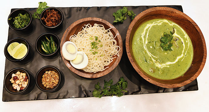 The Green Curry Khao Suey comes in three variants — vegetarian, chicken and prawn. The curry with your choice of protein or vegetables, is made with spiced coconut, chilli and lemongrass and is served with either egg noodles or rice and an assortment of condiments.  Rs 535 prawn variant (in picture)