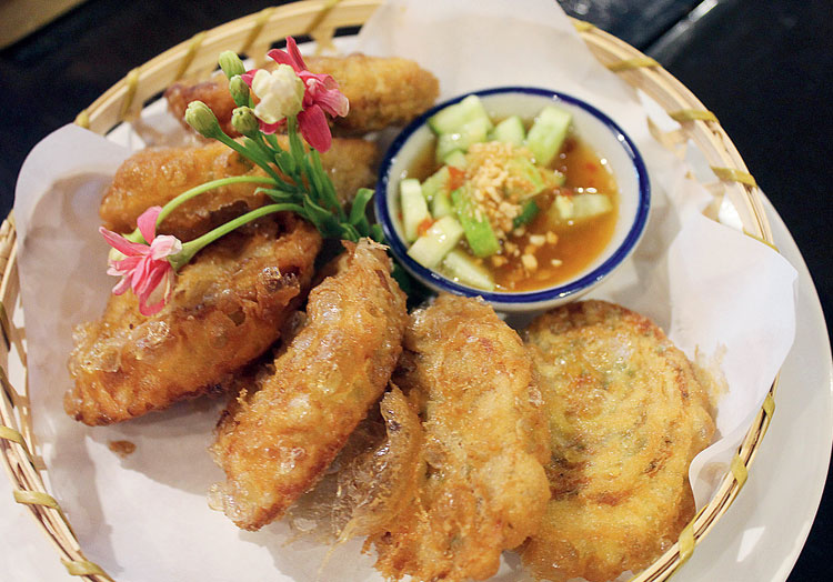 Tod Man Tong Muan is a fish cake dish that comes with a sweet-and-sour dip on the side at Talling Pling