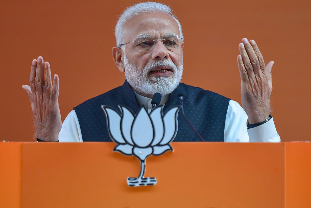 "Addressing the BJP national convention, PM Modi said the Karnataka chief minister was being treated as a ""clerk"" by the Congress and claimed Kumaraswamy had said so."