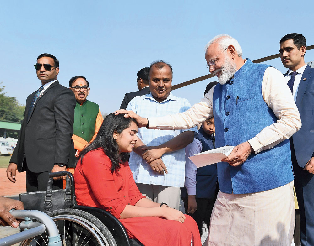 Modi interacts with a differently abled girl  in Varanasi on Tuesday.