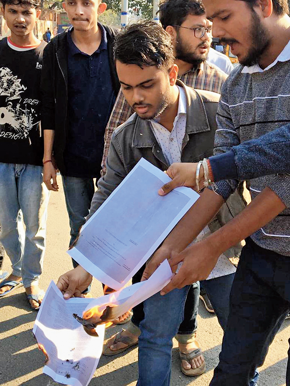 Students burn a photocopy of the bill in Guwahati on Monday.