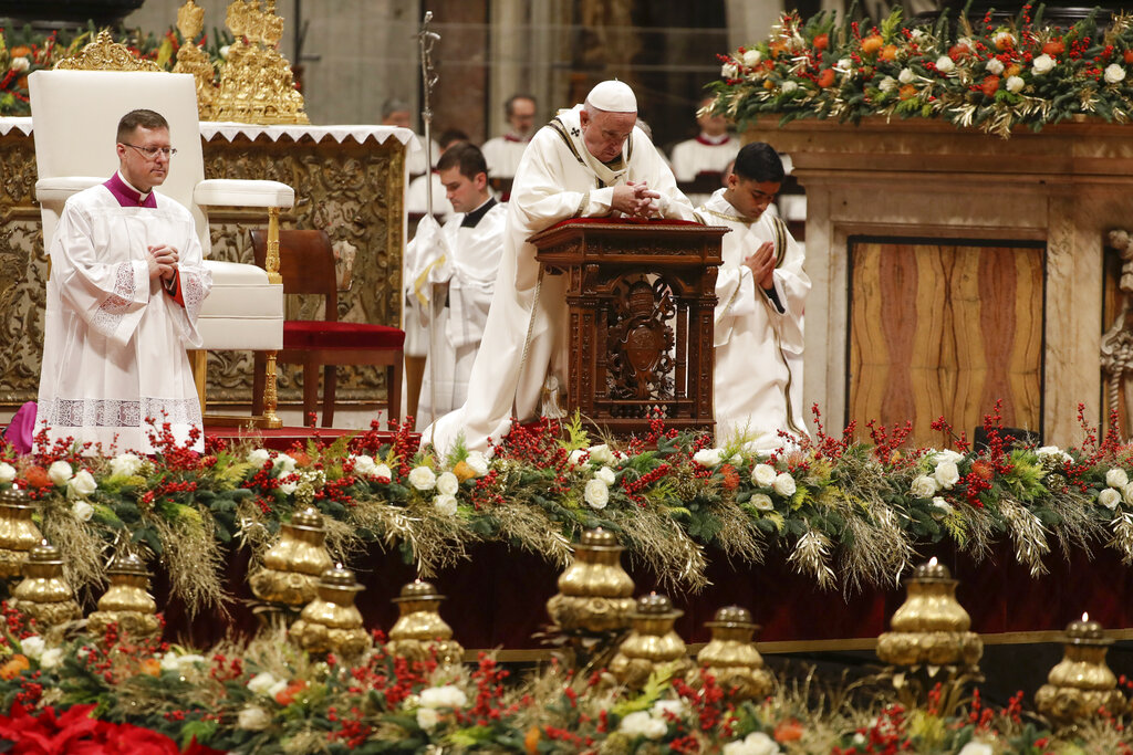Pope Francis prays as he celebrates Christmas Eve Mass in St. Peter's Basilica at the Vatican, Tuesday, Dec. 24, 2019.