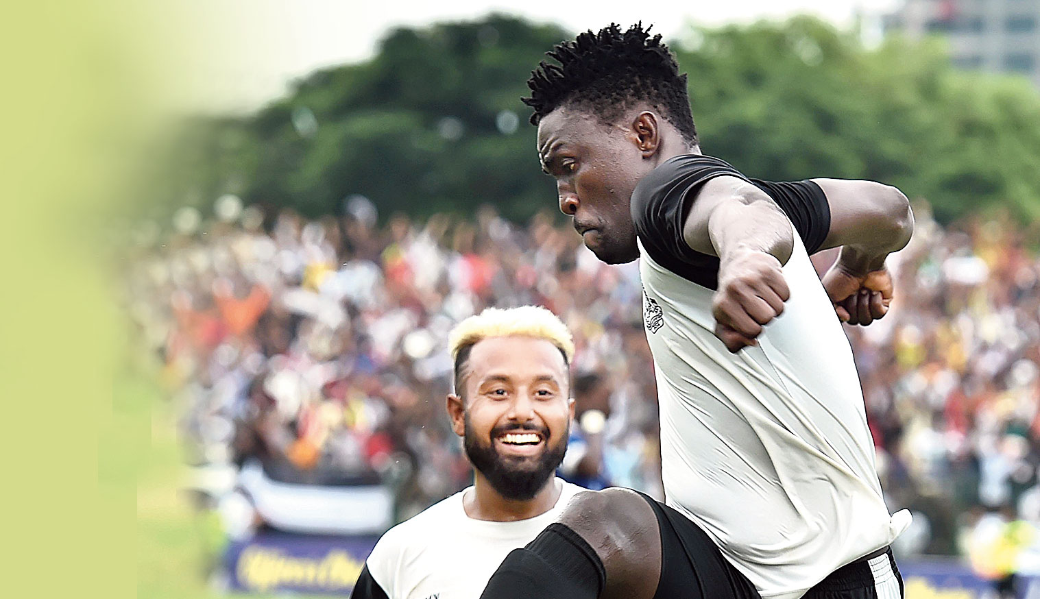 Kareem Omoloja of Mohammedan Sporting celebrates as Tirthankar Sarkar joins in after the former scored the first goal against Peerless SC on Monday.