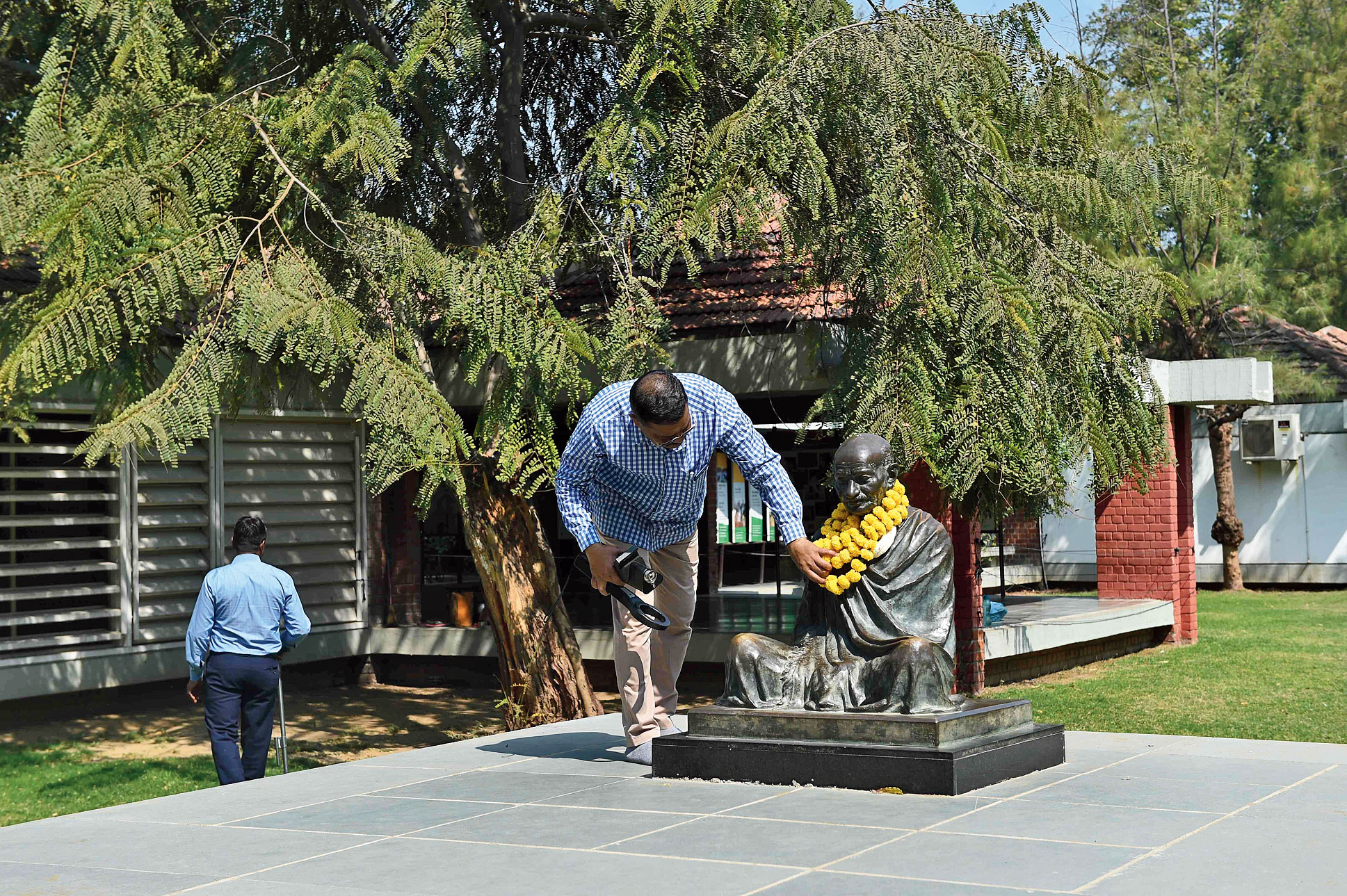 Officials inspect Gandhi Ashram, one of the venues likely to be visited by US President Donald Trump and Prime Minister Narendra Modi, in Ahmedabad on Wednesday.