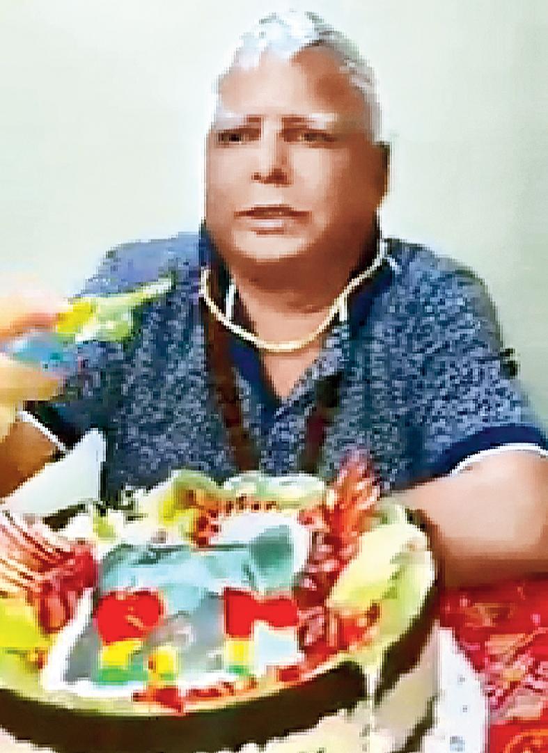 Lalu Prasad celebrates his birthday at his ward at RIMS in Ranchi on Thursday.