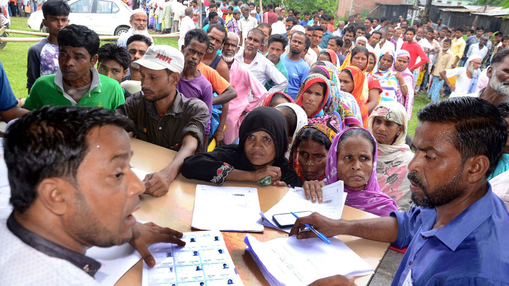 Residents line up for checking the final draft of NRC in Tengabasti, Assam. On July 30, 2018, the complete draft of the NRC was released, with the names of nearly 40 lakh people missing. On June 30 this year, an additional draft list was published with names of another 1.02 lakh excluded names.