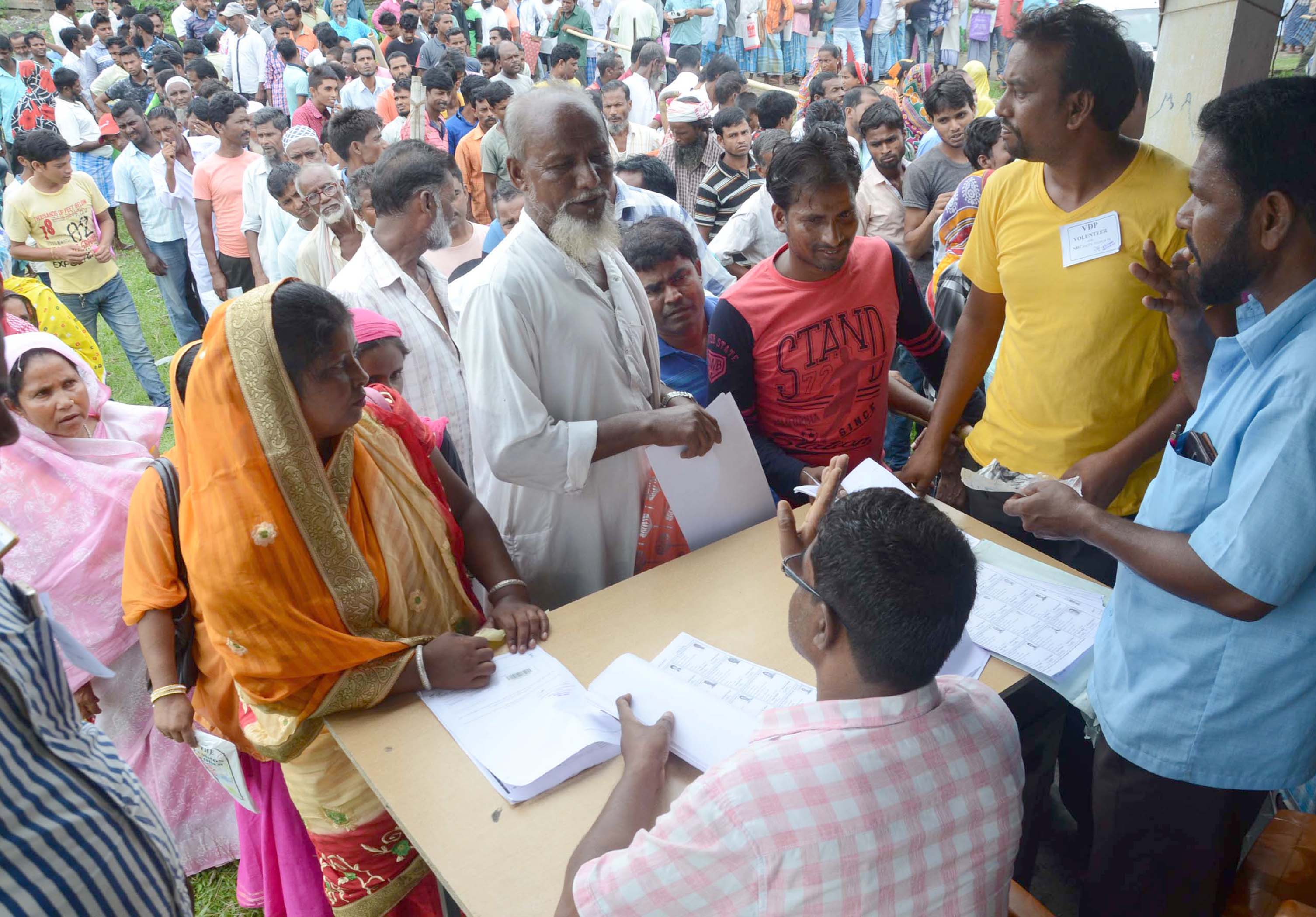People queue up to get their names checked in the draft NRC in Assam's Tezpur on July 30, 2018.