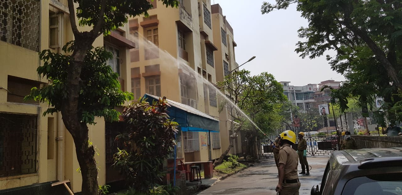 Firemen disinfect a building in Karunamoyee housing complex on Friday