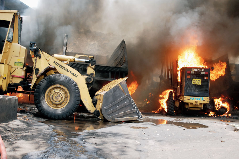 Tipper trucks on fire at BCCL's Bhowra colliery in Dhanbad on Monday.