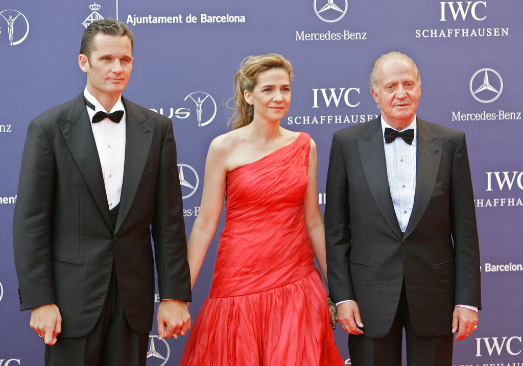 File photo of Spain's King Juan Carlos (right) arriving with his daughter, Princess Cristina and her husband Inaki Urdangarin for the Laureus World Sports Awards in Barcelona