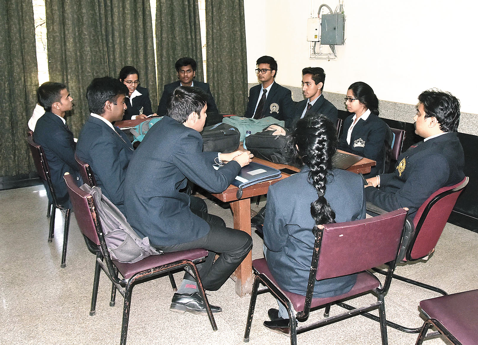 Students of IIT(ISM), Dhanbad, wait for their turn for the placement interview on Thursday.