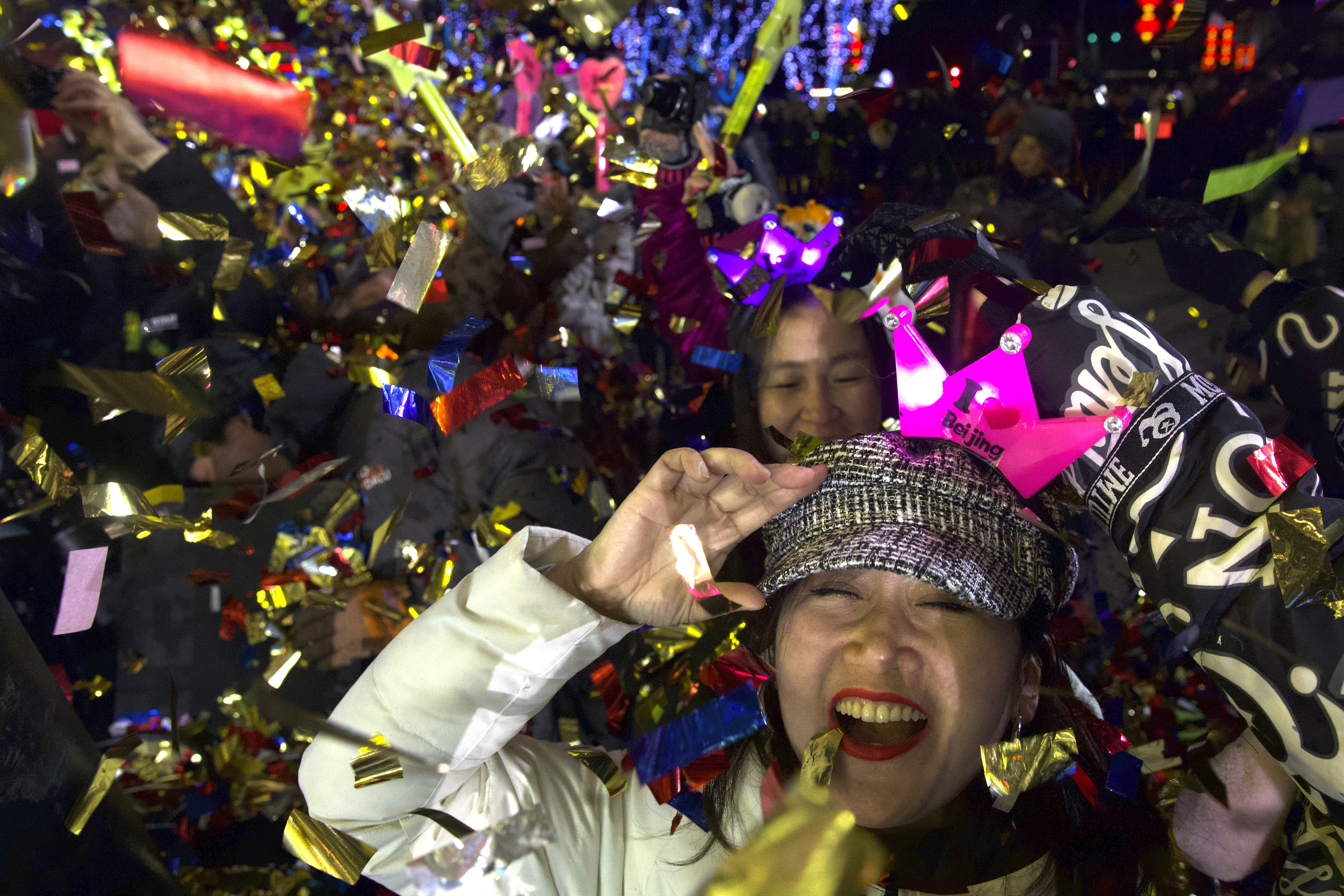 People celebrate the arrival of the year 2020 at a New Year's Eve countdown event near the 2022 Beijing Winter Olympic headquarters in Bejing, on January 1, 2020