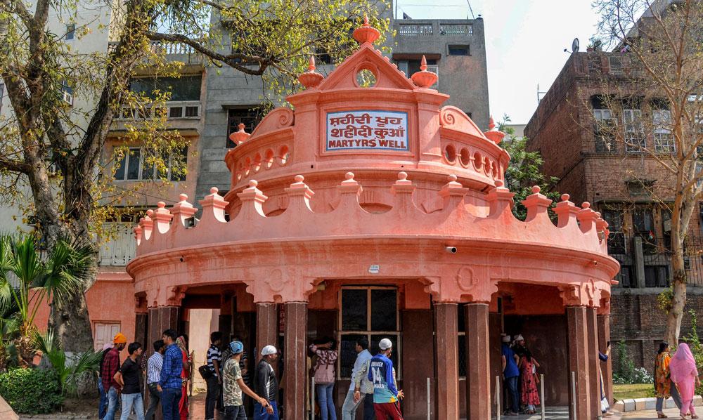 Visitors at the Martyrs' Well at Jallianwala Bagh, Amritsar