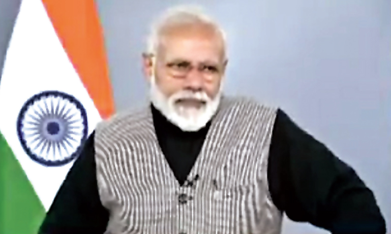 Footage shows Modi listening to the student's question.