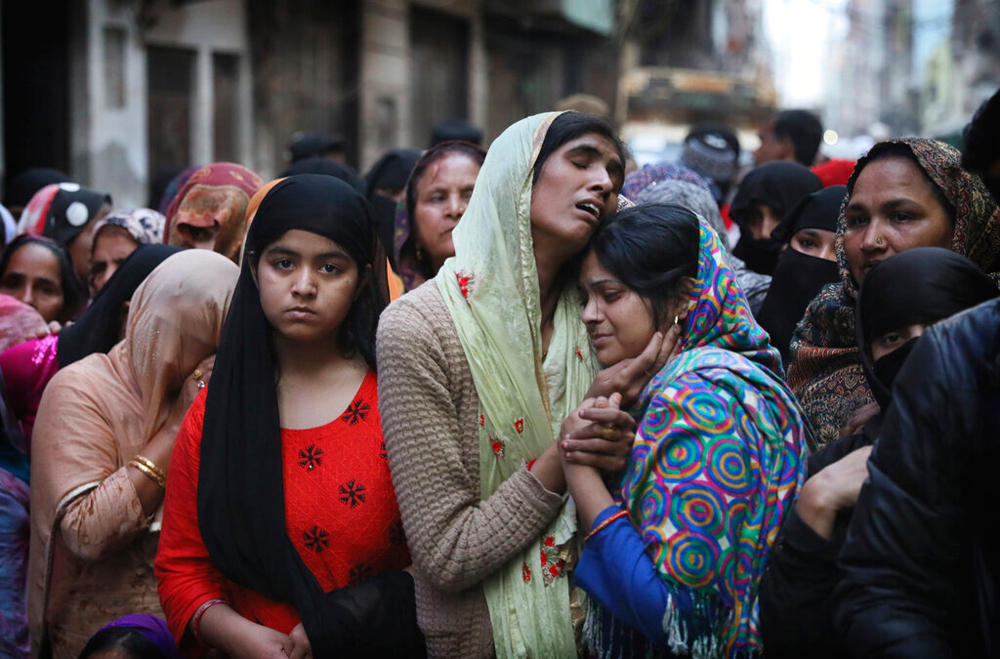 Relatives and neighbours of Mohammad Mudasir who was killed in the violence in New Delhi on Thursday. The riots in the capital have claimed 38 lives so far