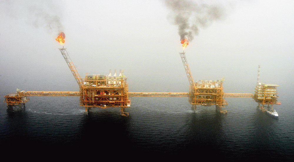Gas flares from an oil production platform at the Soroush oil fields, Iran.