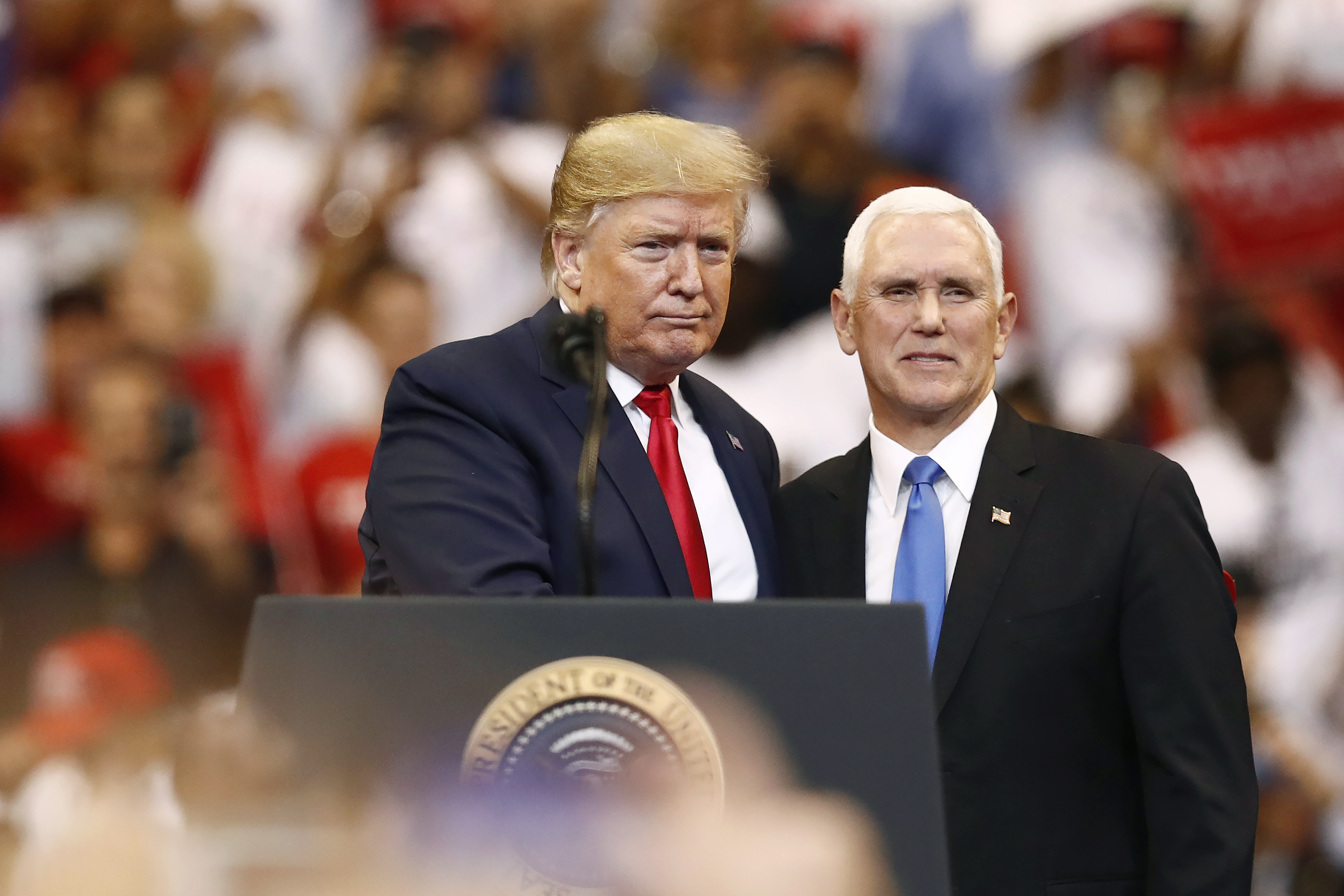 Against reason? US President Donald Trump and Vice President Mike Pence at a campaign rally on November 26, 2019