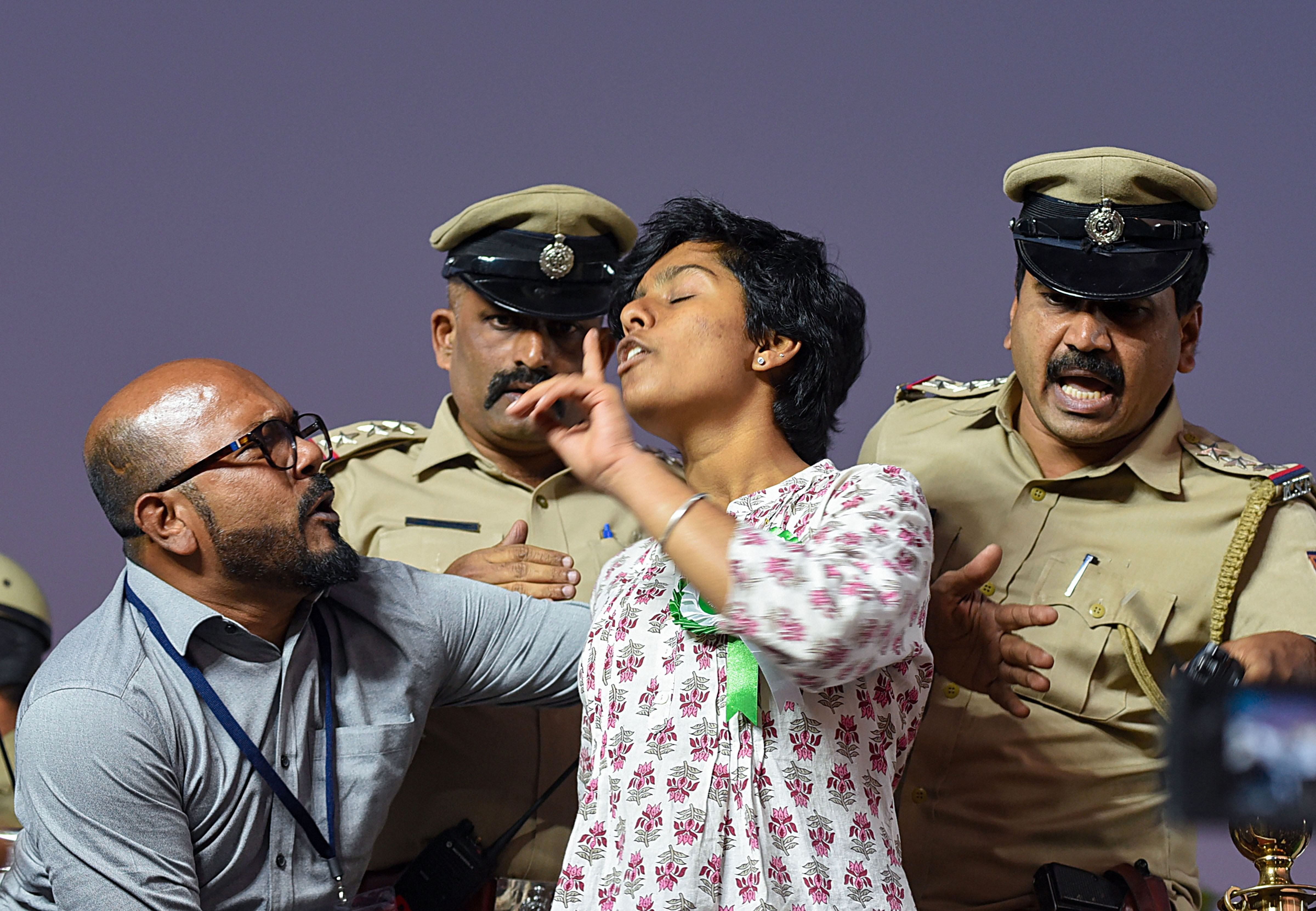 Police personnel attempt to stop a woman who allegedly raised pro-Pakistan slogans during a protest against CAA, NRC and NPR, in Bengaluru, Thursday, February 20, 2020