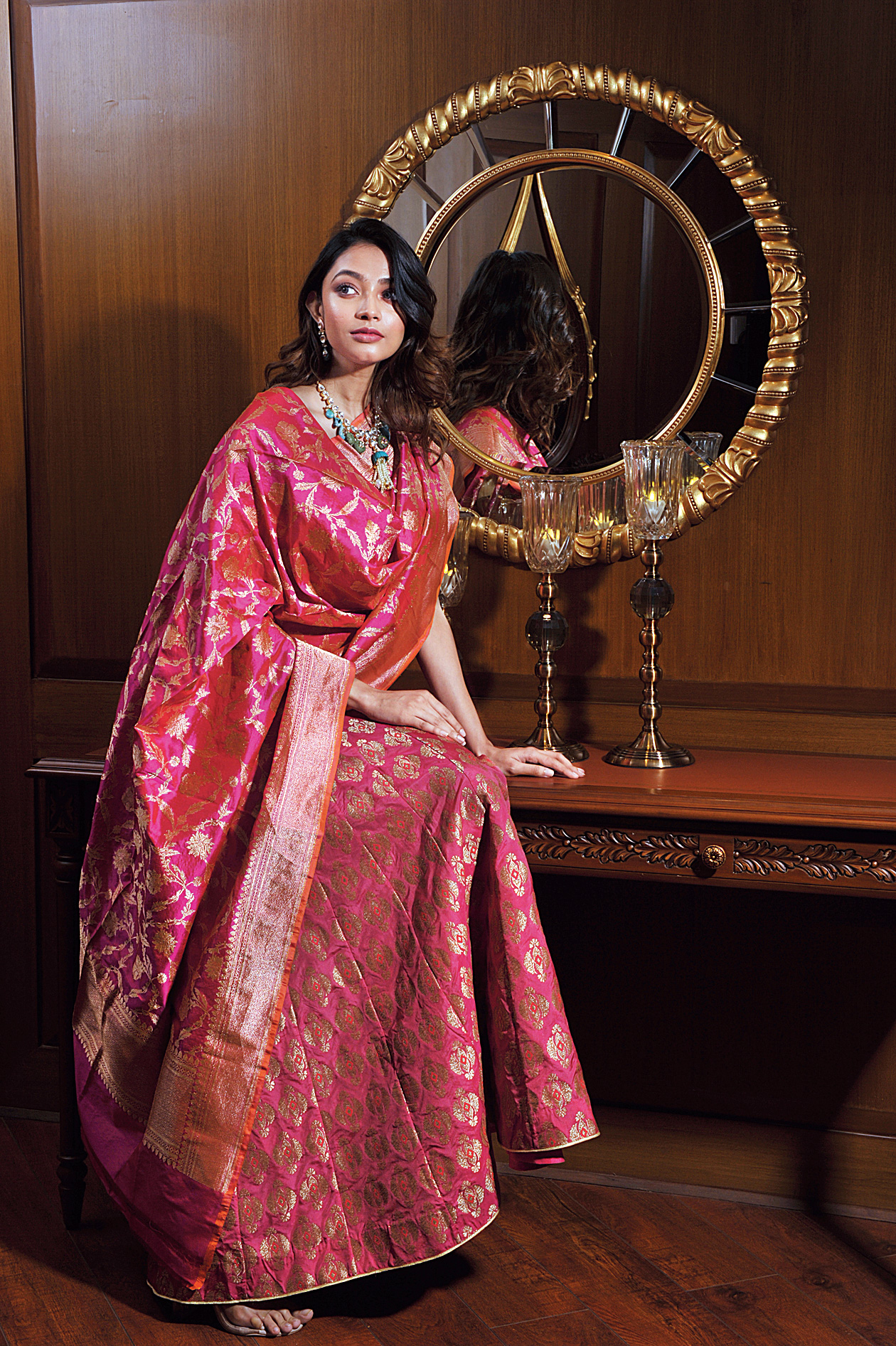 """PINK PRETTY: Not in the mood for a sari but want to dress ethnic? This pink brocade kali skirt with Persian motifs is a good bet. It is paired with a gold blouse and a dupatta in the same hue with """"kadwa"""" weave in """"phool-patti"""" motifs. If you want a more casual look, team the skirt with a black crop top and you're party ready"""