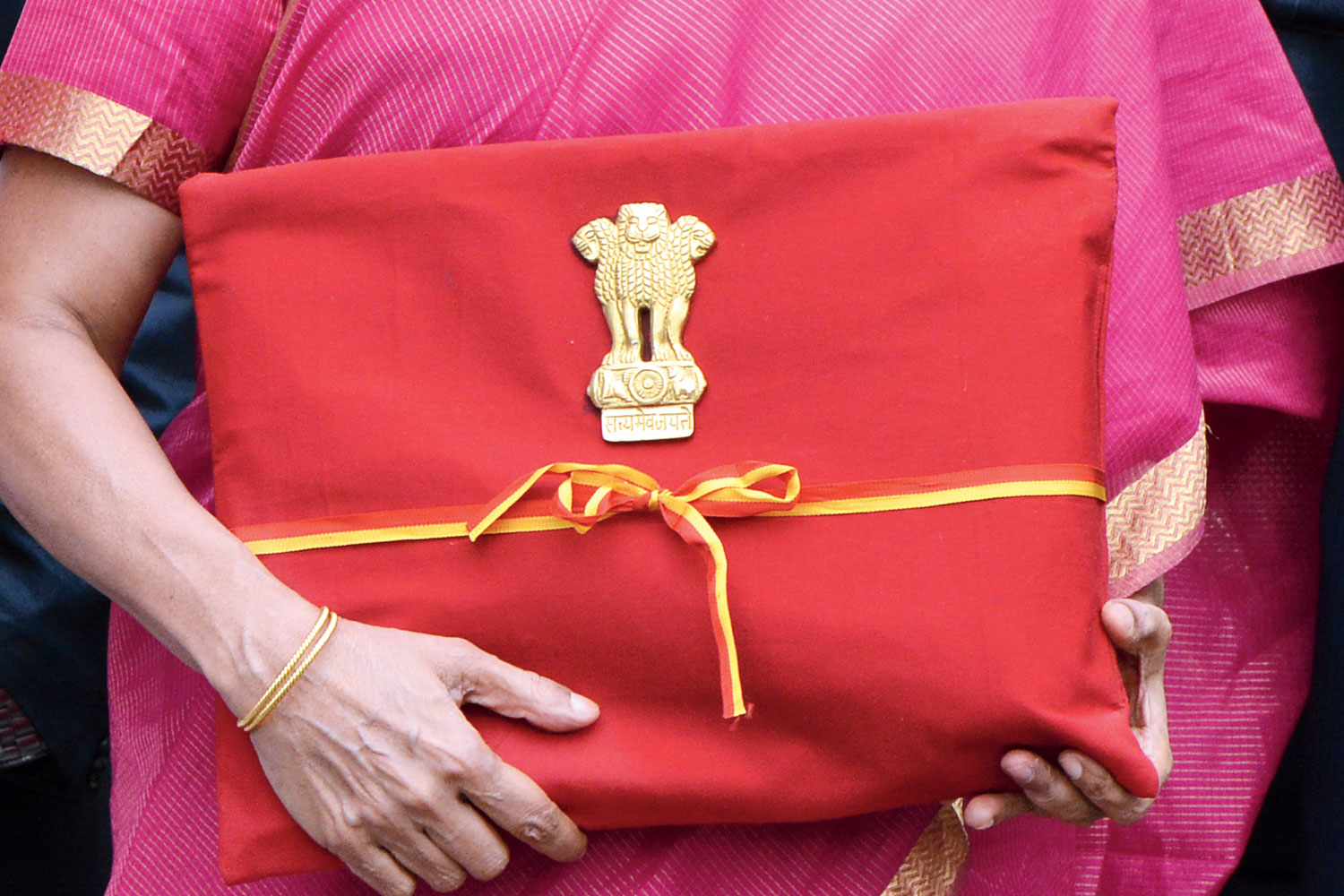 """Finance minister Nirmala Sitharaman carried a """"bahi khata (ledger)"""" wrapped in red, abandoning the briefcase that had become a familiar fixture of earlier annual accounting exercises."""