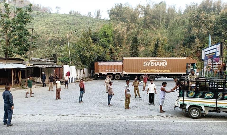 Policemen serve khichdi to residents in Meghalaya's Ri Bhoi district