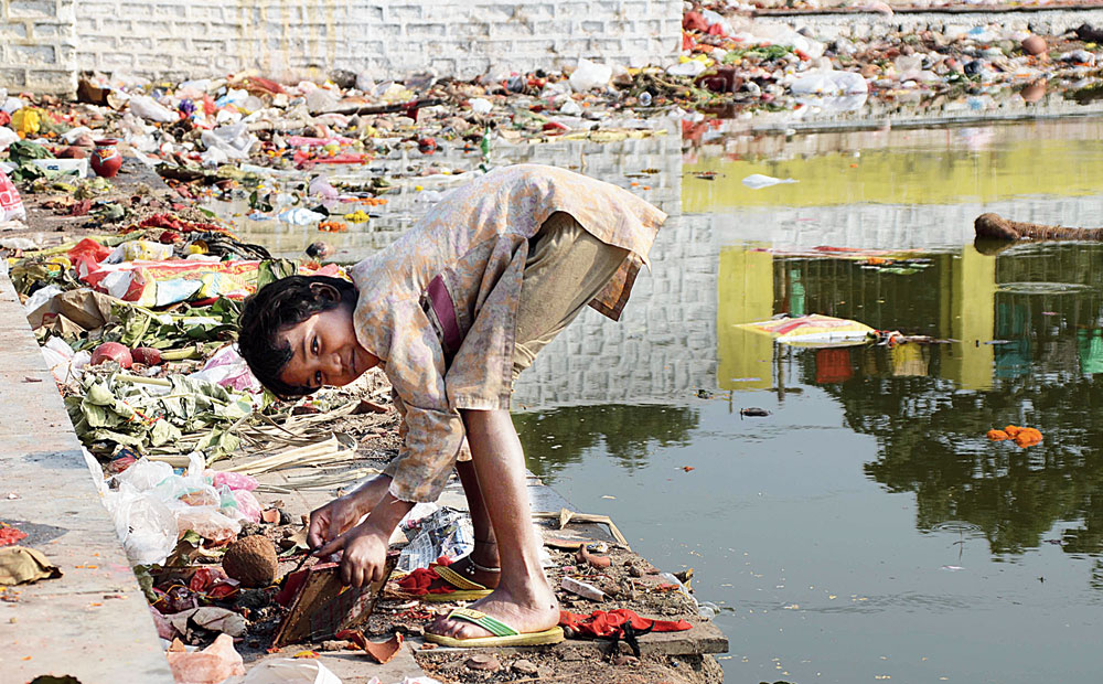 What a mess! Chhath leftovers floating on the water and strewn along the Jail Talab ghat in Ranchi on Monday mock RMC's quick clean-up claims and