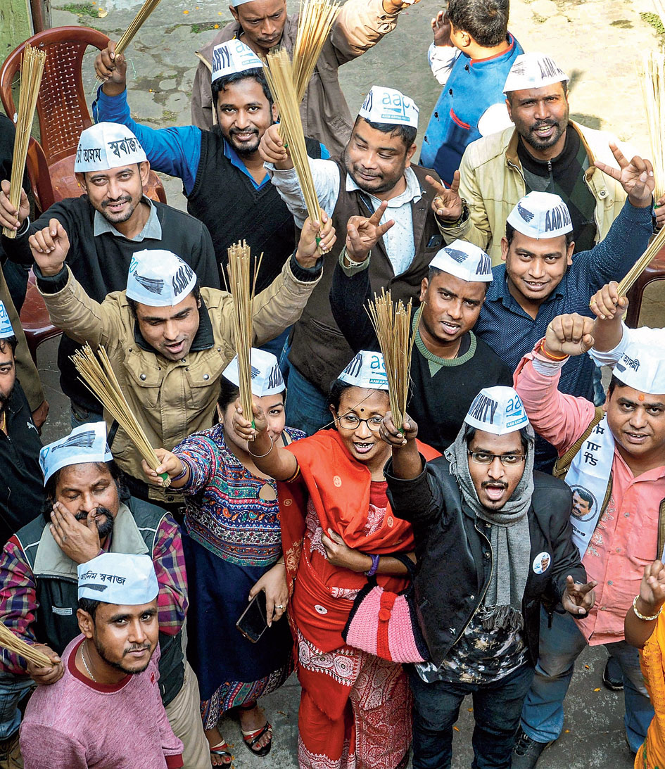 Aam Aadmi Party workers celebrate in Guwahati on Tuesday