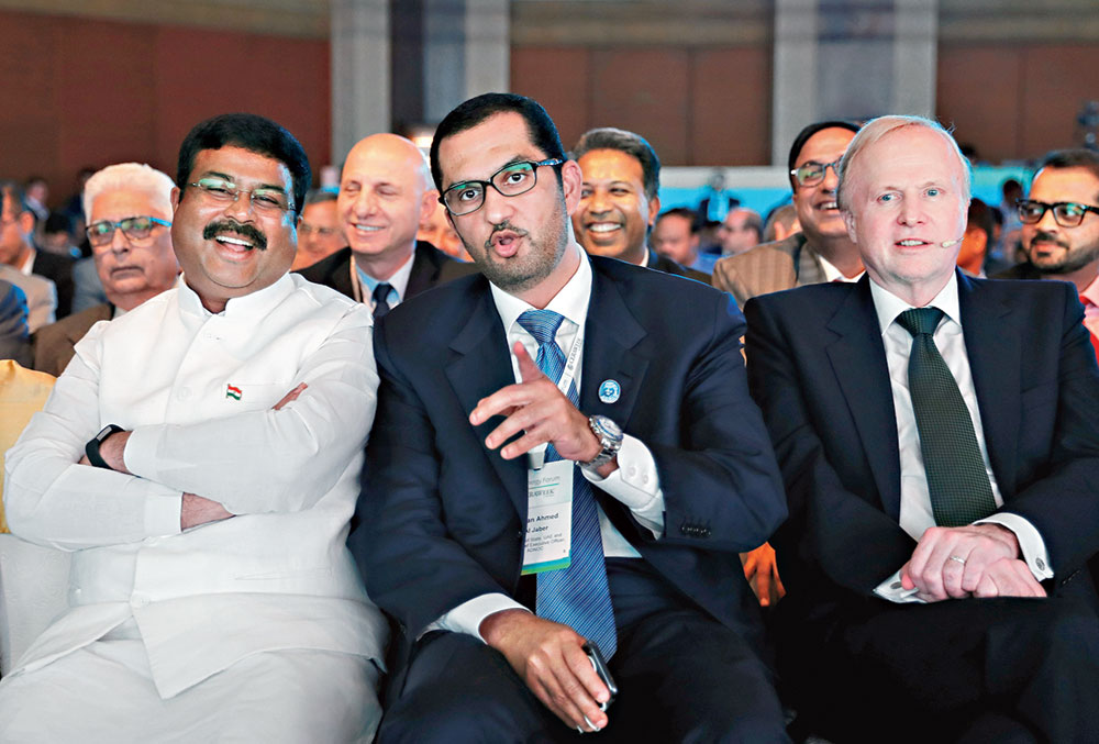 (From left) Dharmendra Pradhan, Adnoc Group CEO Sultan Ahmed Al Jaber and BP chief executive Robert Dudley in New Delhi on Monday.